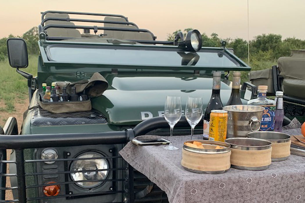 Photo of a LandRover with champagne on a table